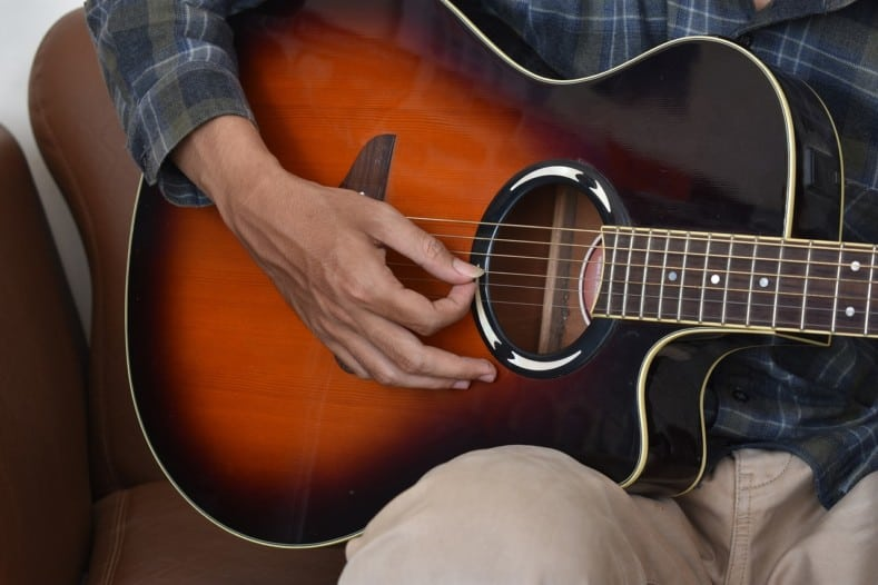 Acoustic Guitar Strumming with Thumb and Index Finger