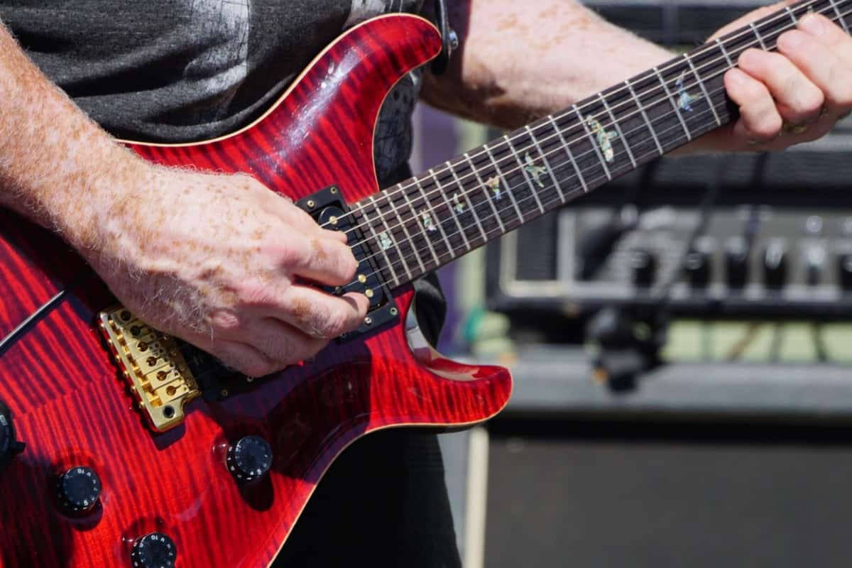 How Long Does it Take to Learn Electric Guitar? Red Electric Guitar