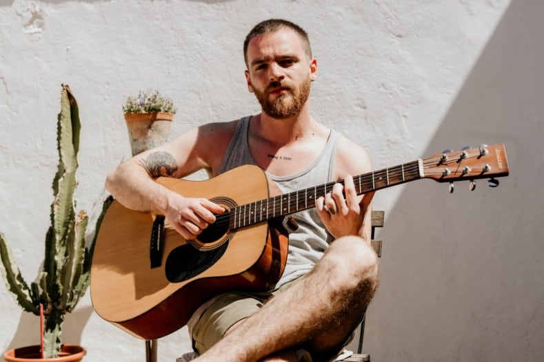 best way to learn guitar for adults - man playing acoustic guitar