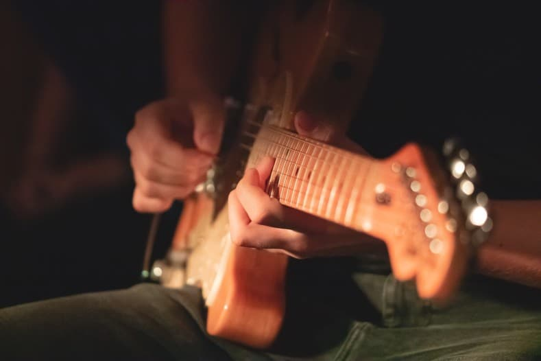 guitar tabs for beginners - man playing electric guitar