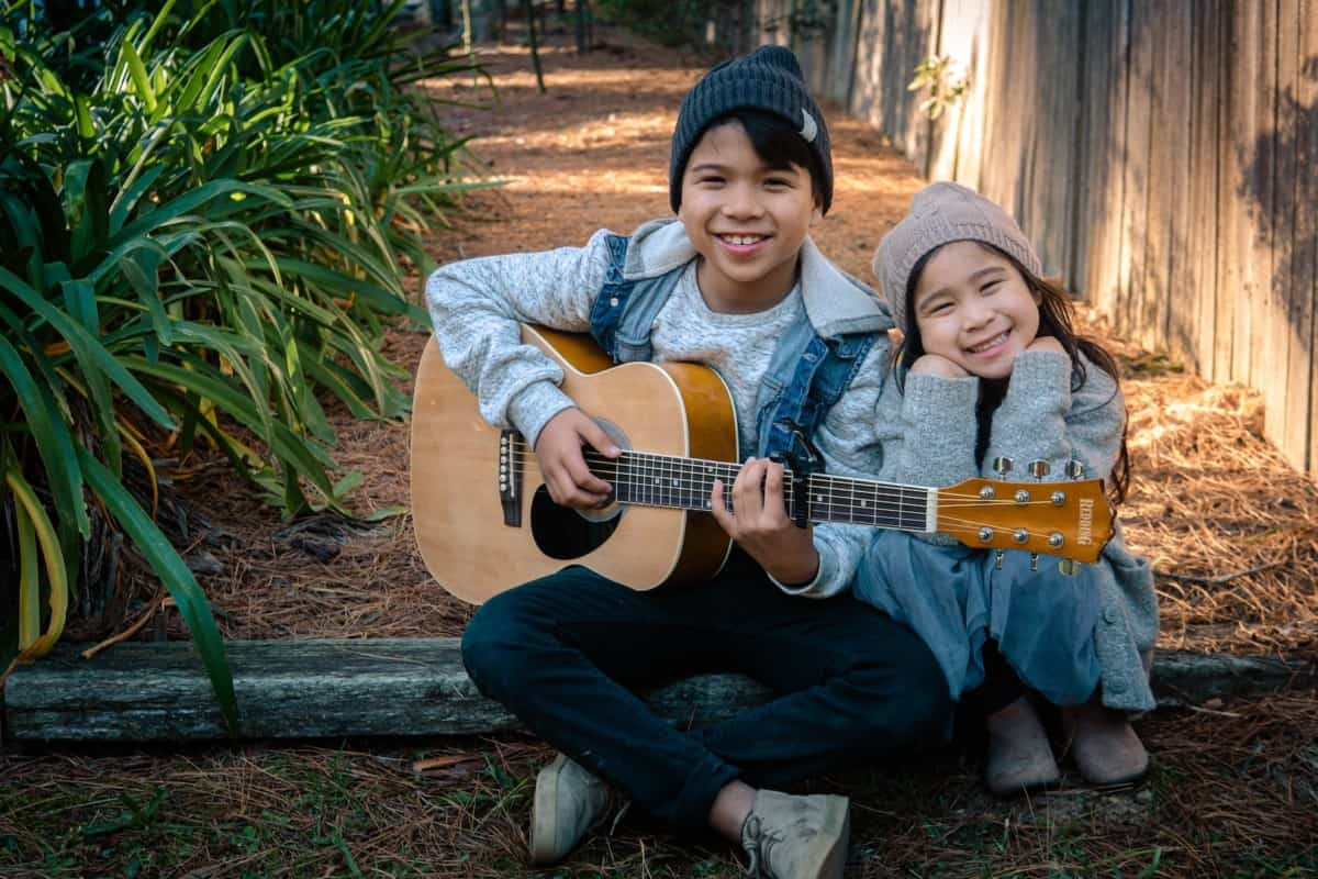 how to teach a child to play guitar - boy and girl are playing guitar