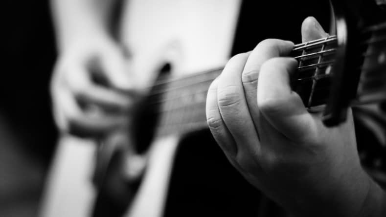 playing guitar with small hands - playing acoustic guitar